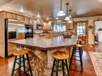 This bright and beautiful kitchen comes fully equipped with all the necessary cooking appliances