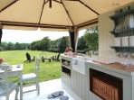 The kitchen and fire pit and a small view of 'Tom Clarke's Hayfield'.
