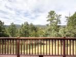 The cabin's private wraparound deck features stunning mountain views!