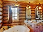 Soak your cares away in the deep master bath tub