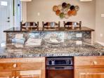 The updated kitchen boasts elegant granite countertops.