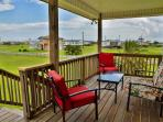 Relax on the front deck and enjoy Galveston's balmy weather!