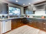 Prepare your favorite meals in the fully equipped gourmet kitchen.