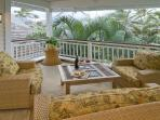 Upstairs lanai overlooks garden and pool with views of the Ko'olau mountains.