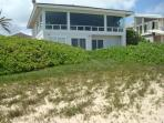 View of the house from the sandy beachwalk.