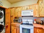 The quaint kitchen is fully equipped with all the necessary appliances and in-unit laundry machines.