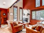 Unwind in this cozy living room and admire the lovely scenery outside