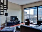 You'll feel right at home inside the apartment's stylishly appointed interior