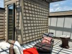 The unit's spiral staircase will take you to the private rooftop cabana!