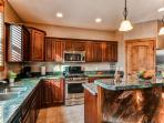 Enjoy preparing delicious family meals in the fully equipped kitchen.
