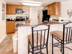 This fully equipped kitchen features stainless steel appliances and granite countertops.