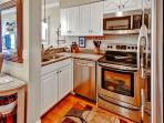 Prepare delicious home-cooked meals in this sleek fully equipped kitchen