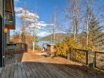 Unwind on the spacious private deck next to the radiating warmth of the outdoor gas fireplace, only steps from the water