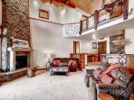 Cozy up next to the magnificent stone fireplace