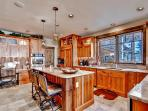 This bright and beautiful kitchen comes fully equipped with all the essential cooking appliances