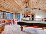 Stay entertained in the home's fabulous huge entertainment room with wet bar and pool table