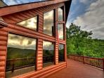 View of the cabin from the front shows you the decks and the large windows which gives you the mountain view.
