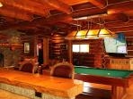 Game room, pool table, poker, bumper, darts, popcorn maker, big screen.