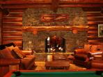 Game room fireplace luxury seating to enjoy the fun.