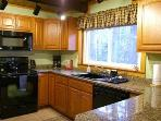 Kitchen w/granite, convection oven, fridge w/filtered ice/water, dishwasher, etc