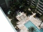 BALCONY VIEW DOWN TO THE POOL AND JACUZZI