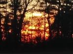 Enjoy a blazing sunset at the end of a wintry day at the Fox River Retreat.