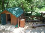 Campfire pit and outbuilding with ice machine.