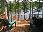 Deck with view of lake