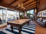 Game room with pool table, wet bar and flatscreen