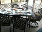 Enjoy dinner on the porch in a tranquil, relaxing setting.