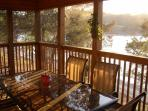Relax in serene comfort in the screened-in porch right on the water's edge.