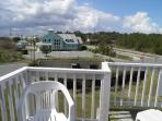 VIEW OF THE CLUBHOUSE FROM TOP DECK OF 1100 C