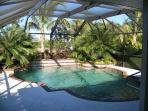 Large privet, heated pool with three waterfalls, fully furnish lanai, BBQ