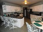 Up-dated kitchen with lots of seating. Plenty of dishes, glasses, utensils, etc.