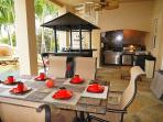 Lanai with outside kitchen (2 grilles, sink, bar fridge and outdoor vent)