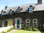 Our gorgeously spacious Irish stone cottage is a mile from Portrush on the Causeway Coast.