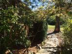 Flagstone walkway receives much sunshine once leaves have fallen