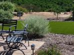 Seating area with Turf in the background.
