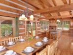 Farmhouse style dining table sits 10; dining is open to the kitchen
