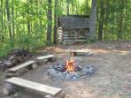\\\'little log cabin\\\' playhouse and firepit in the back yard