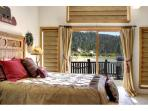 Master bedroom has sliding doors with views of lake and access to the patio
