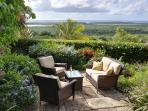 Enjoy coffee or a glass of wine on your private terrace overlooking the Caribbean