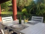 Enjoy a romantic meal on the covered rear patio surrounded by tropical plants
