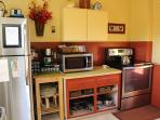 Well equipped kitchen with all new stainless steel appliances. There is also a Keurig coffee maker,