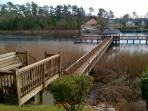 Community pier with boat day dock and seating on ICW. Fishing w/permit.
