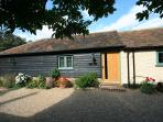 Set in a pretty courtyard, The Stables is clad with traditional Kentish clapboard