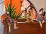 Burmese puppets play in Moroccan Room bureau
