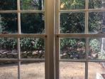 View of stone patio from the kitchen, perfect for grilling out or a relaxing cup of coffee.