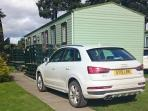 Exterior shot of the caravan showing the parking space.