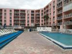 Pool deck, jacuzzi, tennis courts, BBQ Grills with tables